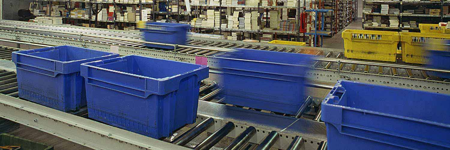 bins on conveyor tracks in warehouse